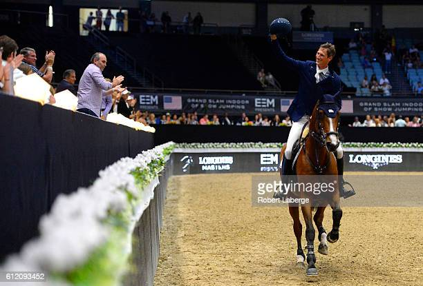 Daniel Deusser of Germany celebrates after winning during the Longines Grand Prix event at the Longines Masters of Los Angeles 2016 at the Long Beach...