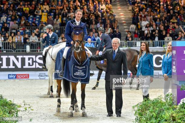 Daniel Deusser of Germany riding Calisto Blue and Mr John Roche Director of Jumping FEIduring prize giving cerimony the Longines FEI Jumping World...