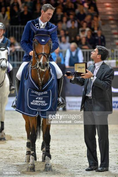 Daniel Deusser of Germany riding Calisto Blue end Fabrizio Giaccon Brand Manager Longines Italia during prize giving cerimony the Longines FEI...