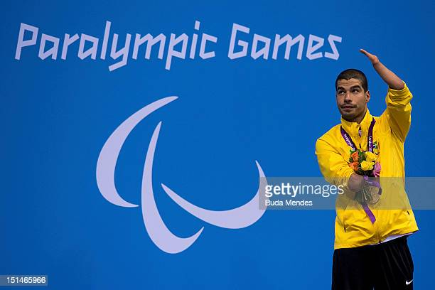 Daniel Dias of Brazil celebrates a gold medal in the Men's 50m Butterfly S5 final on day 9 of the London 2012 Paralympic Games at Aquatics Centre on...