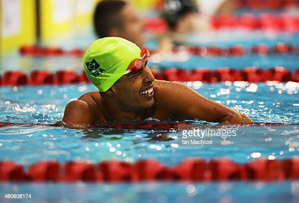 Daniel Dias of Brazil celebrates after winning the Men's 100m Backstroke S5 during Day One of The IPC Swimming World Championships at Tollcross...