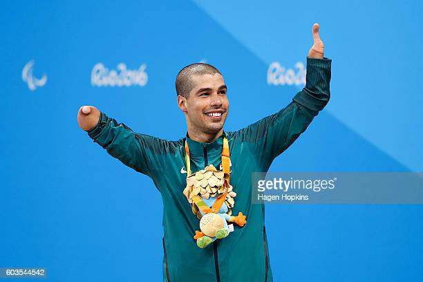 Daniel Dias of Brazil celebrates on the podium after winning the gold medal in the Men's 50m Freestyle S5 final on day 5 of the Rio 2016 Paralympic...