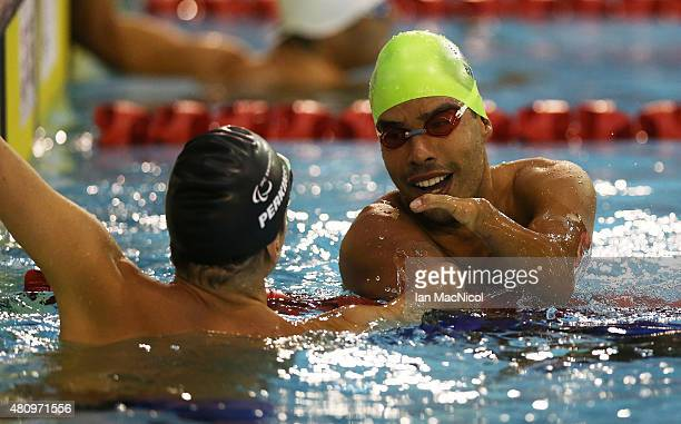 Daniel Dias of Brazil celebrates victory in the Men's 50m Butterfly S5 final during day Four of the IPC Swimming World Championships at Tollcross...