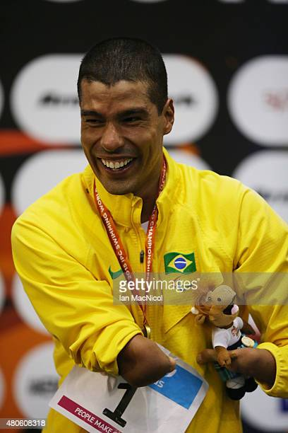 Daniel Dias of Brazil poses with his gold medal after winning the Men's 100m Backstroke S5 during Day One of The IPC Swimming World Championships at...