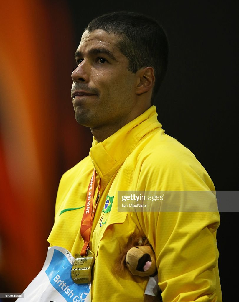 Daniel Dias of Brazil poses with his gold medal after winning the Men's 100m Backstroke S5 during Day One of The IPC Swimming World Championships at Tollcross Swimming Centre on July 13, 2015 in Glasgow, Scotland.