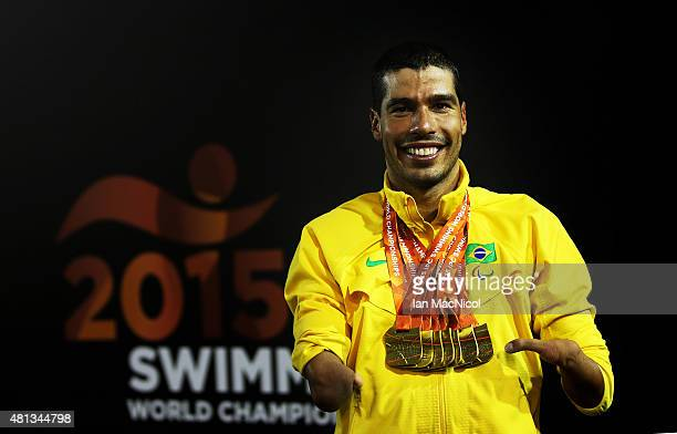 Daniel Dias of Brazil poses with his seven gold medal he won during the week during Day Seven of The IPC Swimming World Championships at Tollcross...