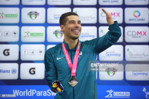 Daniel Dias of Brazil smiles with his gold medal in Men's 50 m Backstroke S5 during day 3 of the Para Swimming World Championship Mexico City 2017 at...