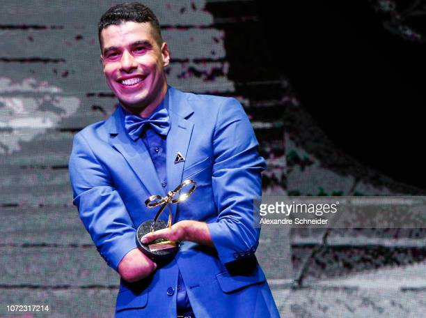 Daniel Dias paralympic swimmer poses for photo after winning the best swimmer athlete during the Brazil Paralympics Awards Ceremony 2018 at...