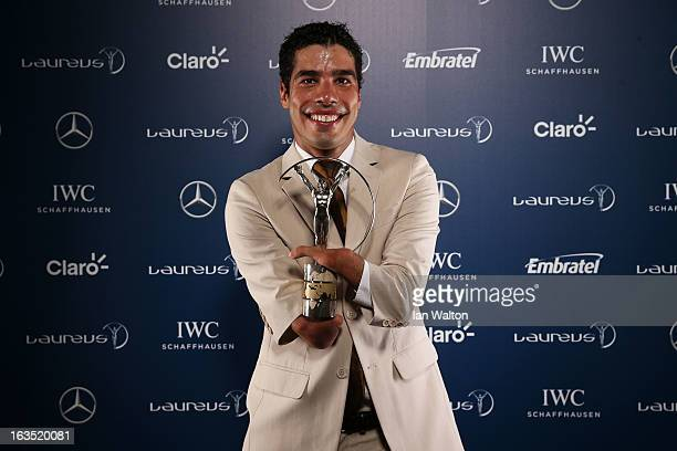 Daniel Dias poses with the award for Laureus World Sportsperson of the Year with a Disability in the winners studio during the 2013 Laureus World...