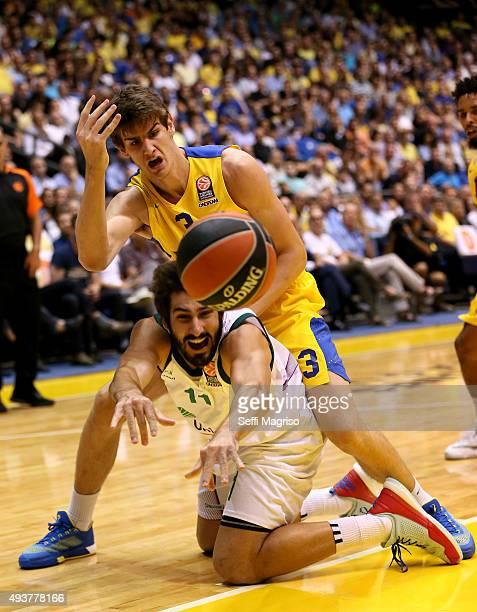 Daniel Diaz #11 of Unicaja Malaga competes with Dragan Bender 3 of Maccabi Fox Tel Aviv during the Turkish Airlines Euroleague Regular Season date 2...