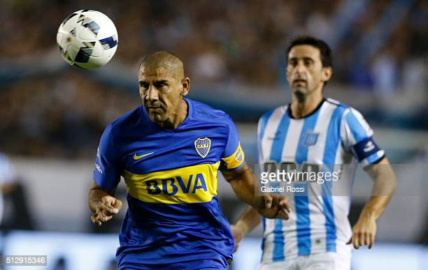Daniel Diaz of Boca Juniors heads the ball during a fifth round match between Racing Club and Boca Juniors as part of Torneo Transicion 2016 at...