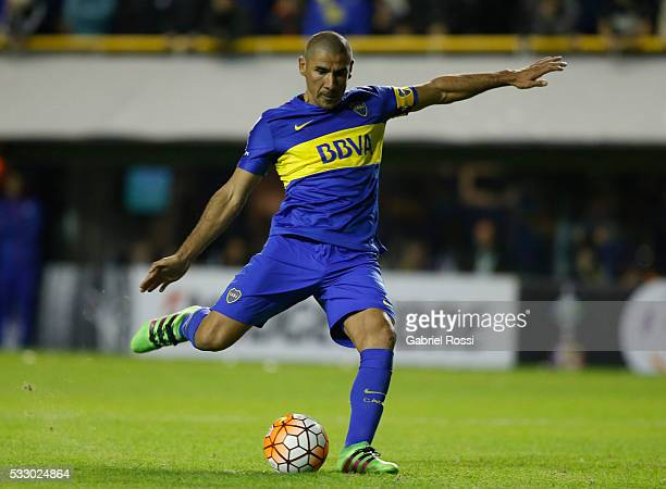 Daniel Diaz of Boca Juniors kicks from the penalty spot during a second leg match between Boca Juniors and Nacional as part of quarter finals of Copa...
