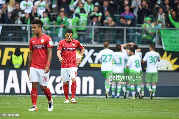 Daniel Didavi of Stuttgart and Filip Kostic of Stuttgart react after the second goal of Wolfsburg during the Bundesliga match between VfL Wolfsburg...