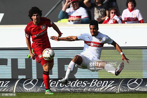 Daniel Didavi of Stuttgart is challenged by Andre Ramalho of Leverkusen during the Bundesliga match between VfB Stuttgart and Bayer Leverkusen at...