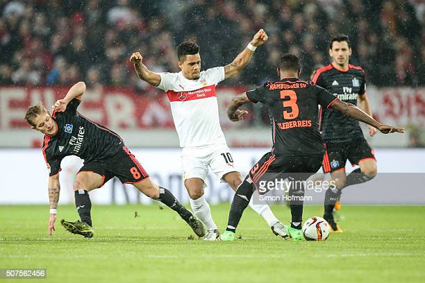 Daniel Didavi of Stuttgart is challenged by Cleber Reis and Lewis Holtby of Hamburg during the Bundesliga match between VfB Stuttgart and Hamburger...