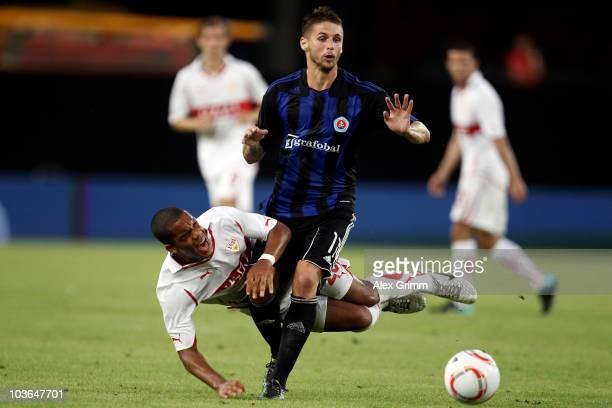 Daniel Didavi of Stuttgart is challenged by Mario Bozic of Bratislava during the UEFA Europa League playoff second leg match between VfB Stuttgart...