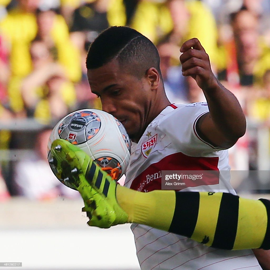 Daniel Didavi of Stuttgart is challenged by Sebastian Kehl of Dortmund during the Bundesliga match between VfB Stuttgart and Borussia Dortmund at Mercedes-Benz Arena on March 29, 2014 in Stuttgart, Germany.