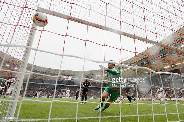 Daniel Didavi of Stuttgart scores his team's first goal past goalkeeper Manuel Neuer of Muenchen during the Bundesliga match between VfB Stuttgart...