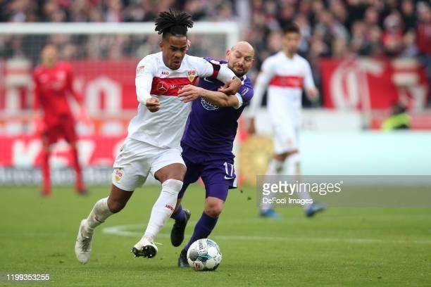 Daniel Didavi of VfB Stuttgart and Philipp Riese of Erzgebirge Aue battle for the ball during the Second Bundesliga match between VfB Stuttgart and...