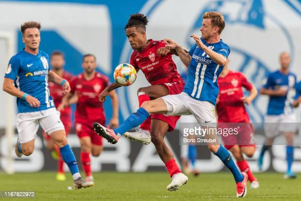 Daniel Didavi of VfB Stuttgart is challenged by Maximilian Ahlschwede of Hansa Rostock during the DFB Cup first round match between Hansa Rostock and...