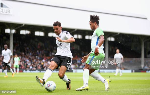 Daniel Didavi of VfL Wolfsburg and Ryan Fredericks of Fulham battle fore possession during the PreSeason Friendly match between Fulham and VfL...