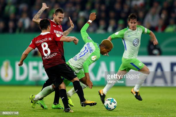 Daniel Didavi of Wolfsburg and Manuel Schmiedebach of Hannover battle for the ball during the DFB Cup match between VfL Wolfsburg and Hannover 96 at...
