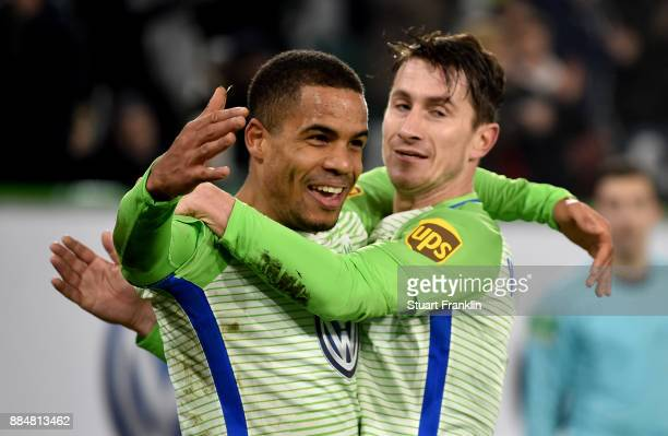Daniel Didavi of Wolfsburg celebrate with tam mate Paul Verhaegh after scores the second goal during the Bundesliga match between VfL Wolfsburg and...