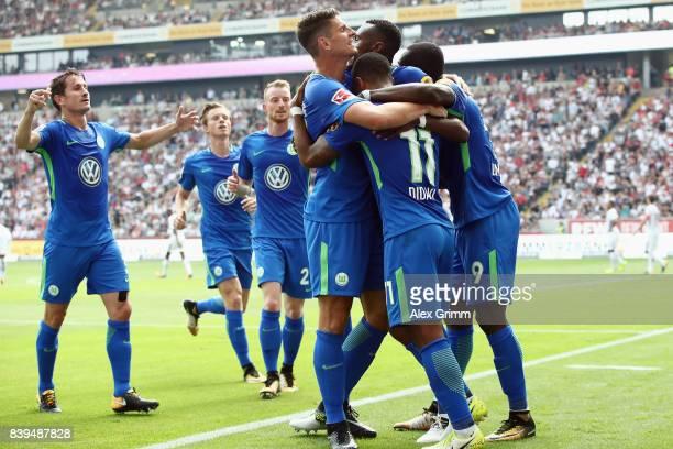 Daniel Didavi of Wolfsburg celebrates his team's first goal with team mates during the Bundesliga match between Eintracht Frankfurt and VfL Wolfsburg...