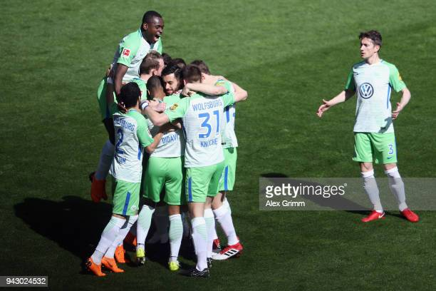 Daniel Didavi of Wolfsburg celebrates his team's first goal with team mates during the Bundesliga match between SportClub Freiburg and VfL Wolfsburg...