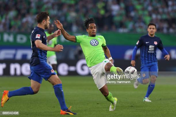 Daniel Didavi of Wolfsburg vies with Ken Reichel of Braunschweig during the Bundesliga Playoff first leg match between VfL Wolfsburg and Eintracht...