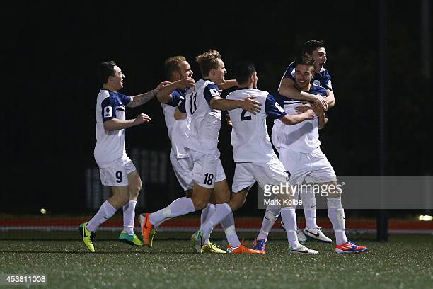 Daniel Dragicevic of the Palm Beach Sharks is congratulated by his team mates after scoring a goal during the FFA Cup match between Hakoah Sydney...
