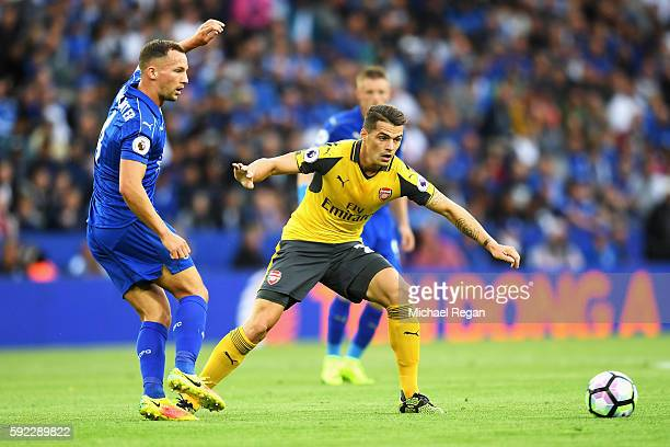 Daniel Drinkwater of Leicester City and Granit Xhaka of Arsenal watch the ball during the Premier League match between Leicester City and Arsenal at...