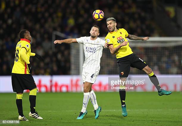 Daniel Drinkwater of Leicester City and Valon Behrami of Watford battle to win a header during the Premier League match between Watford and Leicester...