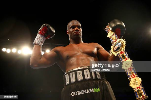 Daniel Dubois celebrates victory over Nathan Gorman by holding the British Heavyweight Title after the British Heavyweight Title fight between Daniel...