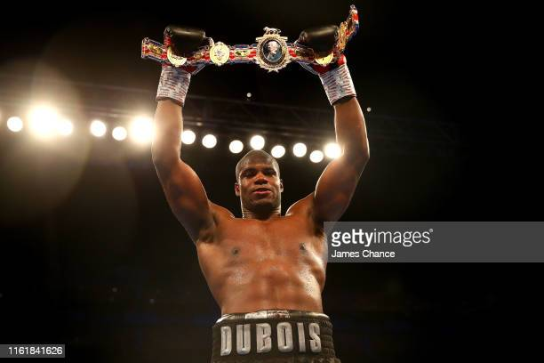 Daniel Dubois celebrates victory over Nathan Gorman by holding up the British Heavyweight Title after the British Heavyweight Title fight between...