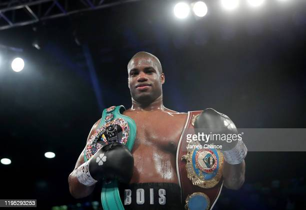 Daniel Dubois celebrates with the belts after knocking out Kyotaro Fujimoto during the WBC Silver and WBO International Heavyweight Title fight...