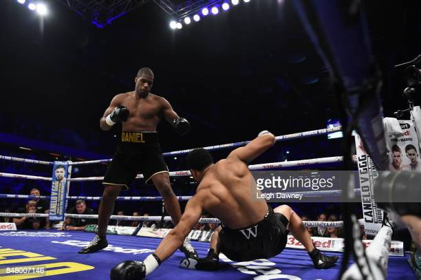 Daniel Dubois knocks down AJ Carter during the vacant BBBofC Southern Area Heavyweight Title fight at Copper Box Arena on September 16 2017 in London...