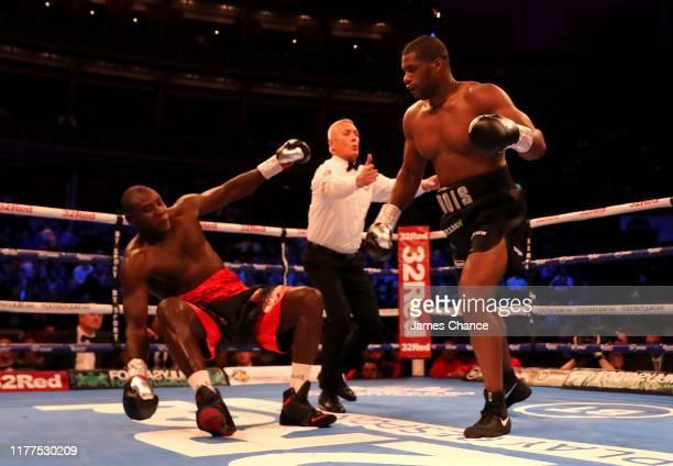 Daniel Dubois knocks down Ebenezer Tetteh during the Commonwealth and WBO International Heavyweight Championship Title fight between Daniel Dubois...
