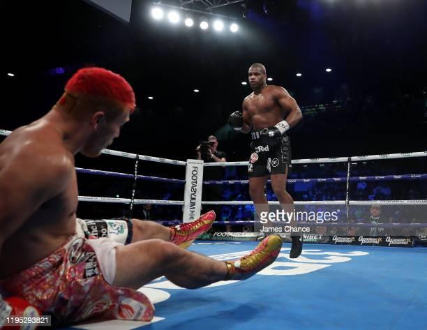 Daniel Dubois knocks down Kyotaro Fujimoto during the WBC Silver and WBO International Heavyweight Title fight between Daniel Dubois and Kyotaro...