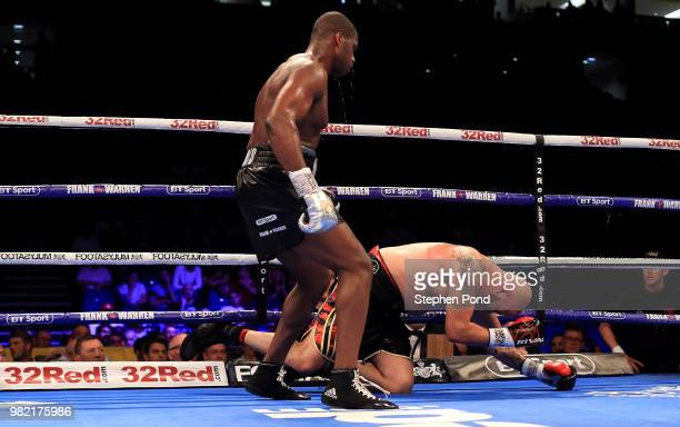 Daniel Dubois knocks down Tom Little during their English Heavyweight Championship contest fight at The O2 Arena on June 23 2018 in London England