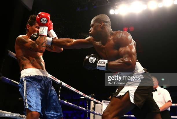 Daniel Dubois of Great Britain and Mauricio Barragan of Uruguay exchange blows during their WBC World Youth Heavyweight Championship bout at Copper...