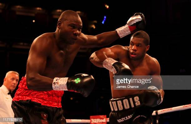 Daniel Dubois punches Ebenezer Tetteh during the Commonwealth and WBO International Heavyweight Championship Title fight between Daniel Dubois and...