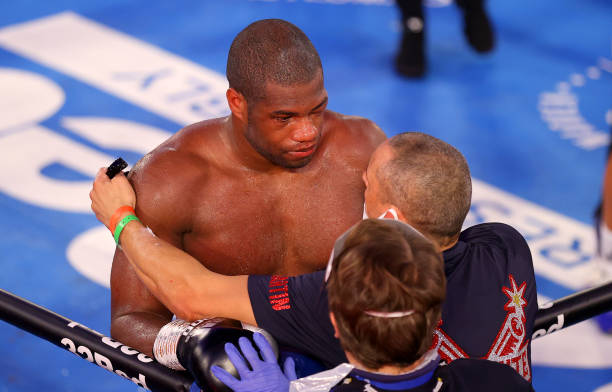Daniel Dubois reacts to defeat with his trainer Martin Bowers after the WBC Silver heavyweight title, British, Commonwealth and European Heavyweight...