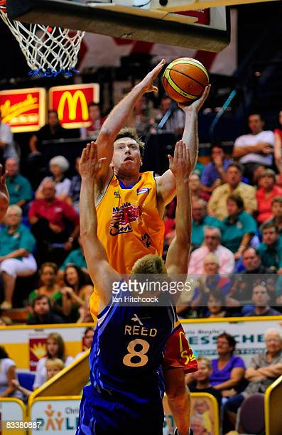 Daniel Egan of the Crocs makes a shot over Clint Reed of the Spirit during the round six NBL match between the Townsville Crocodiles and the Sydney...