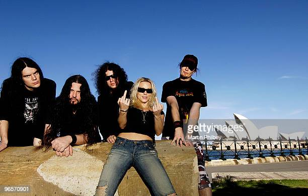 LR Daniel ErlandssoSharlee D'Angelo Fredrik Akessonn Angela Gossow and Michael Amott of Arch Enemy pose for a group portrait in November 2005 in...