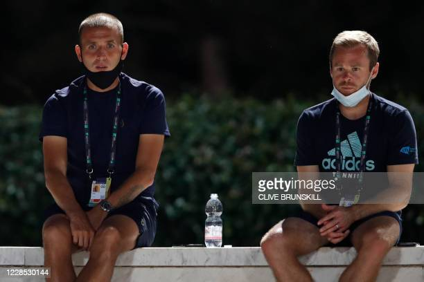 Daniel Evans of Britain and his coach Mark Hilton of Britain watch the match between Kyle Edmund of Britain and Marco Cecchinato of Italy on day two...