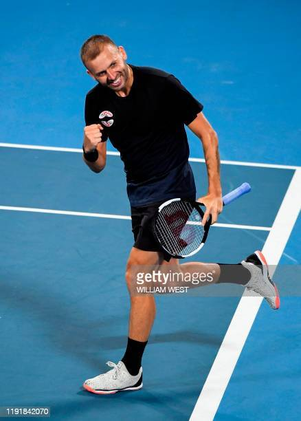 Daniel Evans of Britain celebrates winning his men's singles match against David Goffin of Belgium at the ATP Cup tennis tournament in Sydney on...