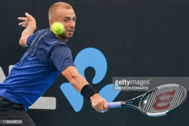 Daniel Evans of Britain hits a return against Juan Ignacio Londero of Argentina during their men's singles first round match at the Adelaide...
