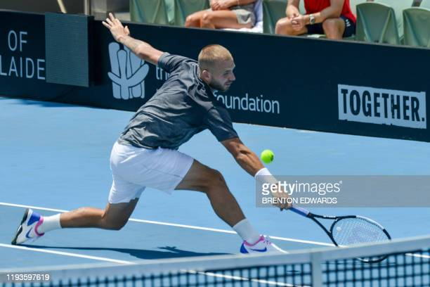 Daniel Evans of Britain hits a return to Alexander Bublik of Kazakhstan during their men's second round singles match at the Adelaide International...