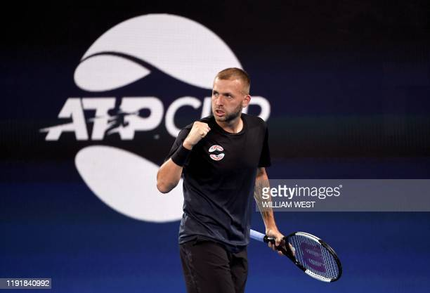 Daniel Evans of Britain reacts after winning a point in his men's singles match against David Goffin of Belgium at the ATP Cup tennis tournament in...